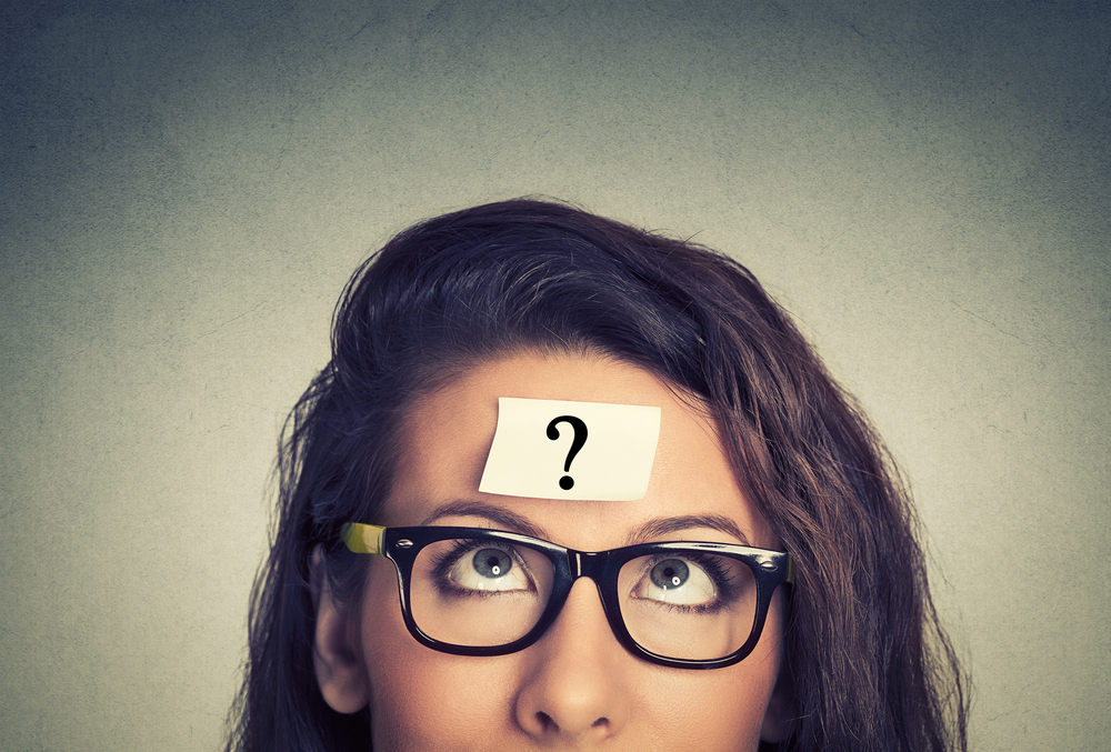 Girl with question mark on her head